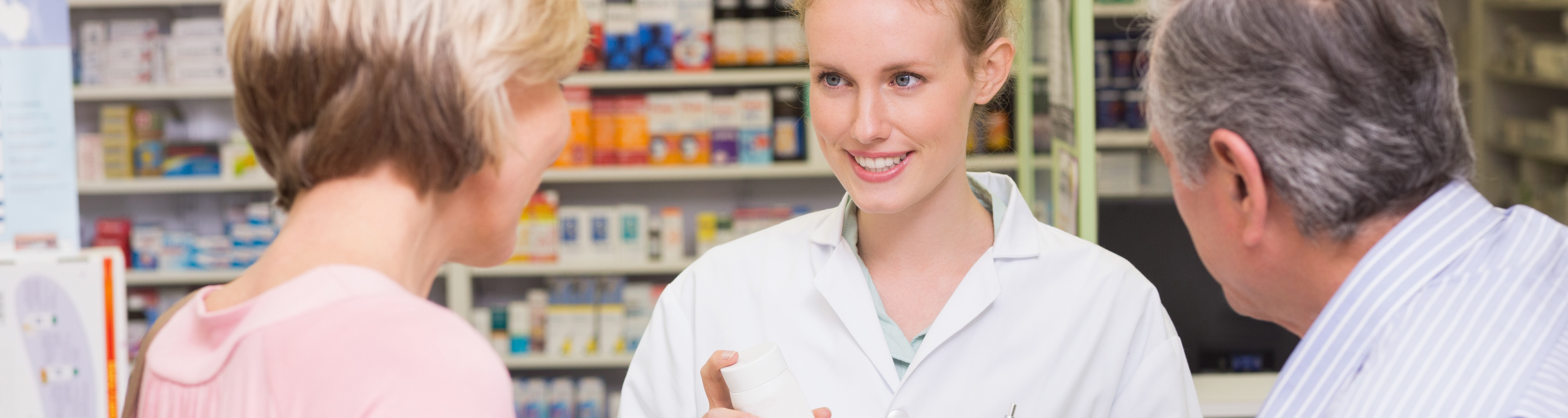 Pharmacist assisting customers